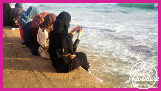 Muslim girls sitting by the water, Galle Face Green, Colombo, Sri Lanka
